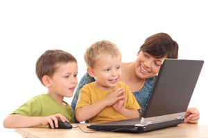 mom and kids at computer